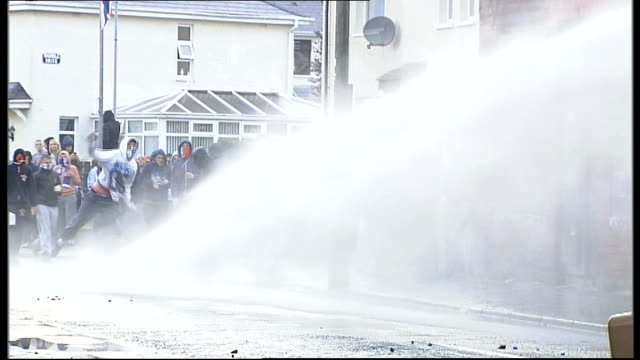 rioting following restrictions on orange order march route northern ireland belfast ardoyne ext water cannon being used on orange order rioters... - water cannon stock videos and b-roll footage