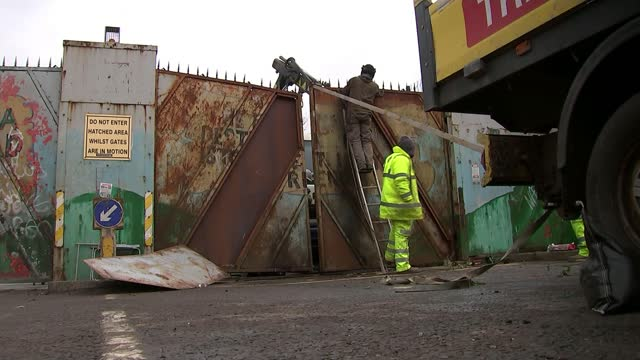 sectarian violence continues as northern ireland assembly meets; northern ireland: west belfast: ext digger being used to clear remains of a burnt... - welding stock videos & royalty-free footage