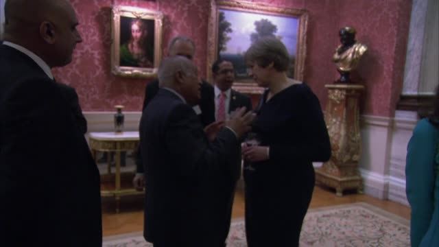 Northern Ireland talks collapse with 'no prospect of devolution' ENGLAND London Buckingham Palace INT Theresa May MP stands talking with others at...