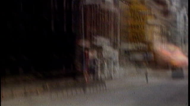 vídeos de stock e filmes b-roll de talks to save power sharing government continue 1970's ireland belfast ext various of british soldiers and armoured vehicles on the street during the... - belfast