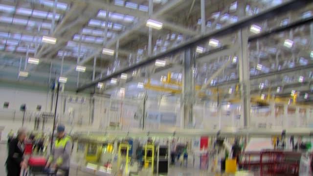 Theresa May visits Bombardier INT GVs Theresa May MP arriving / Theresa May chatting / Theresa May close up / TheresaMay chatting / GVs workers / GVs...