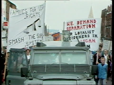 third night of violence in ulster; a) ulster: belfast: shankhill road: night fire in street as police van towards fire by shop as ruc land-rover... - belfast stock videos & royalty-free footage