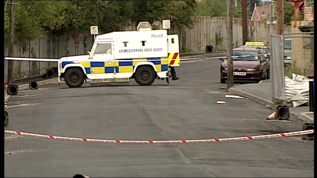 three children hurt by bomb in lurgan northern ireland county armagh lurgan ext school sign pan police van in cordoned off road forensics officers in... - county armagh stock videos and b-roll footage