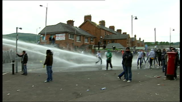 three police officers shot during riots on eve of orange day parade northern ireland belfast ext line of riot police and water cannons across the... - police line up stock videos and b-roll footage