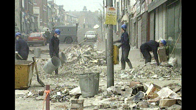 Northern Ireland Troubles compensation payout T24109301 Belfast Shankhill Road EXT Various shots of workers clearing up debris following a massive...