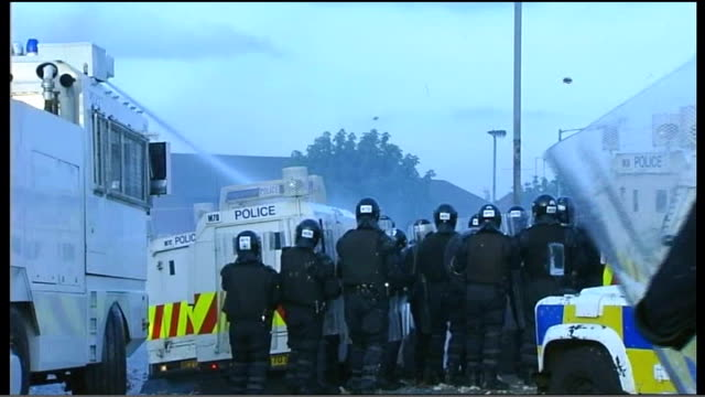 utv northern ireland troubles footage clipreel 169 1272005 ardoyne police vehicles along including one with water cannon as confronting rioters /... - northern ireland stock videos & royalty-free footage
