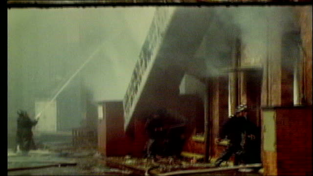 utv northern ireland troubles footage clipreel 43 2541972 northumberland street various of 'robert mitchell co' building on fire smoke billowing from... - northern ireland stock videos & royalty-free footage