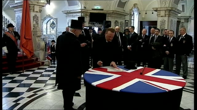 unionist march through belfast to mark centenary of ulster covenant; city hall: int various of people taking part in a re-enactment of the signing of... - belfast stock videos & royalty-free footage