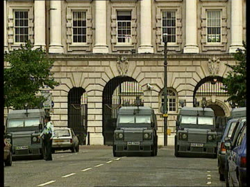 violence in belfast as loyalists tried to disrupt a sinn fein march; northern ireland: belfast: ext bv ruc policeman directing traffic lms two police... - armoured vehicle stock videos & royalty-free footage