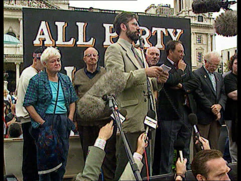 violence in belfast as loyalists tried to disrupt a sinn fein march; b) northern ireland: belfast: ext ltgv mas of republican demos towards tgv man... - arms raised stock videos & royalty-free footage