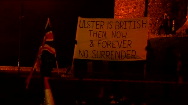 violence in carrickfergus: riot police; northern ireland: county antrim: carrickfergus: ext / night banner 'ulster is british then, now and forever... - ulster county stock videos & royalty-free footage