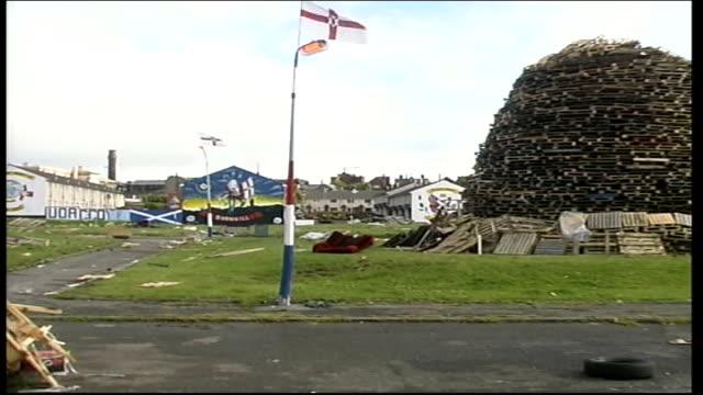 weston park talks loyalist and republican bonfire celebrations itn ireland belfast ext gvs huge bonfire zoom / gv uff mural pull out to bonfire... - loyalty stock videos & royalty-free footage