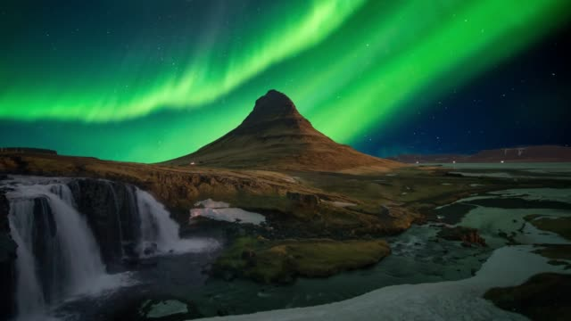 northern light (aurora) or polar light in the night sky kirkjufell iceland - aurora borealis stock videos & royalty-free footage