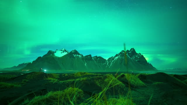 northern light (aurora) or polar light in the night sky vestrahorn iceland at stokksnes iceland - northern europe stock videos & royalty-free footage