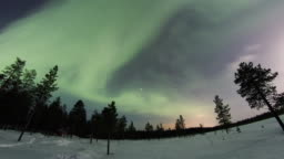 Northern lights above frozen country above arctic in Finland