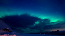 Northern Lights and Clouds in the Night Sky of Lofoten. Time Lapse