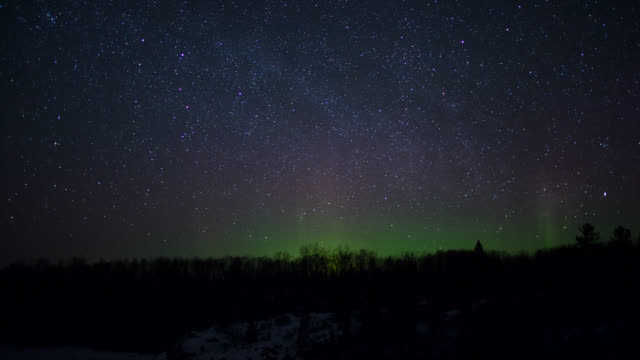 tl northern lights and stars whealing in night sky, usa - stars stock videos & royalty-free footage
