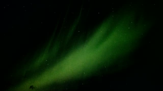 northern lights, aurora borealis flying with starry in the night sky - arctic stock videos & royalty-free footage