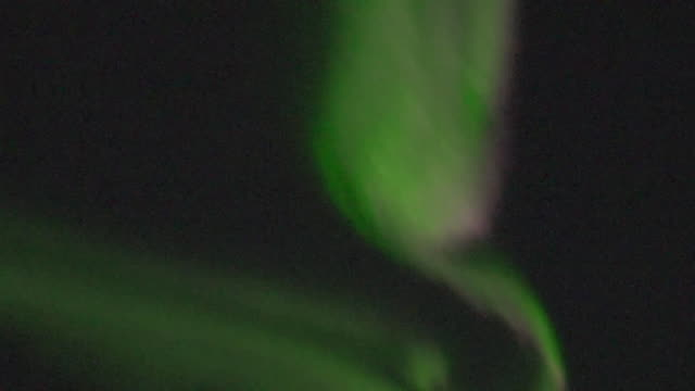 northern lights aurora borealis putting on a light show over the norwegian arctic circle - moody sky stock videos & royalty-free footage
