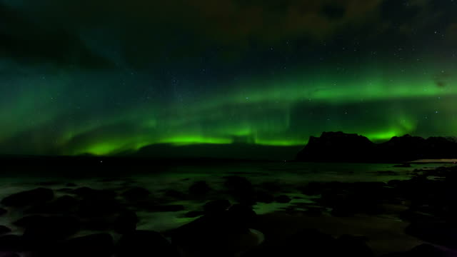 northern lights over a arctic fjord - antarctica night stock videos & royalty-free footage