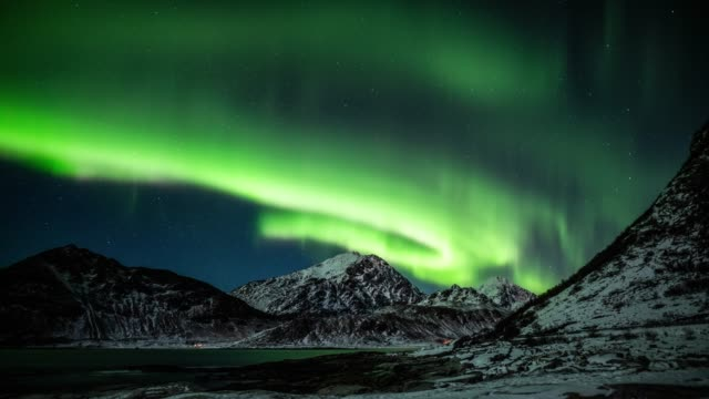northern lights over arctic landscape in norway - aurora borealis stock videos & royalty-free footage
