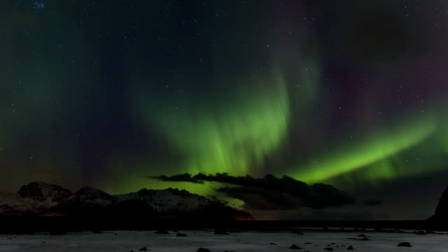 Northern Lights over the frozen Arctic fjord - solar storm