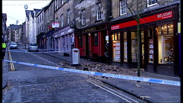 northern parts of uk hit by hurricane force winds; stirling: fallen debris in cordoned-off shopping street - stirling stock videos & royalty-free footage