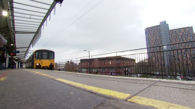 northern rail to be taken into public ownership england ext low angle shot train pulling into station - station stock videos & royalty-free footage