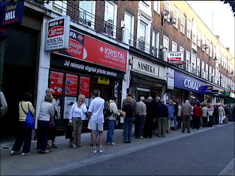 customers queueing outside kingston branch; more of queuing northern rock customers including one reading copy of 'the independent' newspaper with... - terrified stock videos & royalty-free footage