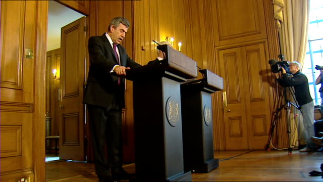 reactions england london int gordon brown mp press conference at podium next alistair darling mp bradby asking a question sot gordon brown mp press... - itv news at ten stock videos & royalty-free footage