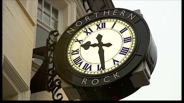 northern rock nationalised; location unknown: ext northern rock clock on wall - itv weekend late news点の映像素材/bロール