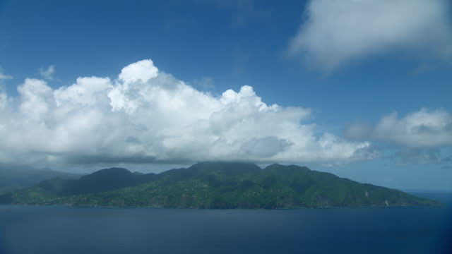 Northern tip of Island of Dominica with view of mountains and volcano.