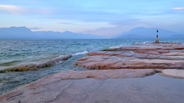 northern tip with navigation marks of peninsula sirmione, sirmione, brescia, lake garda, lago di garda, lombardy, lombardei, italy - lago stock videos & royalty-free footage