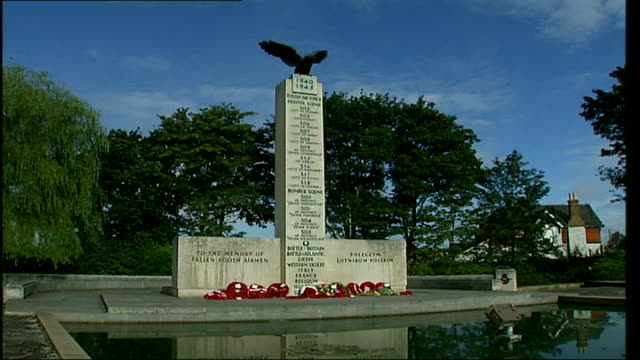 middlesex ruislip royal air force northolt ext gate opening to show memorial statue / general views memorial statue commemorating polish air force /... - air force stock videos & royalty-free footage