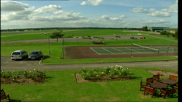 raf northolt / raf uxbridge more high angle views of airfield / high angle view diggers working on building site near edge of airfield / high angle... - court room stock-videos und b-roll-filmmaterial