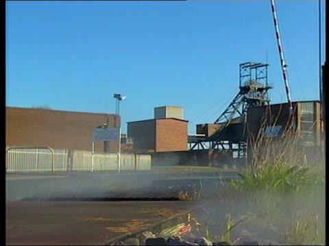 northumberland: gv ellington colliery lms pit wheel lms sign on building 'ellington colliery rjb' gv mine - northumberland video stock e b–roll