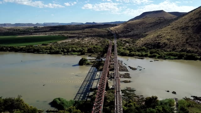 norvalspont rail and road bridge, orange river, eastern cape, south africa - railway track stock videos & royalty-free footage