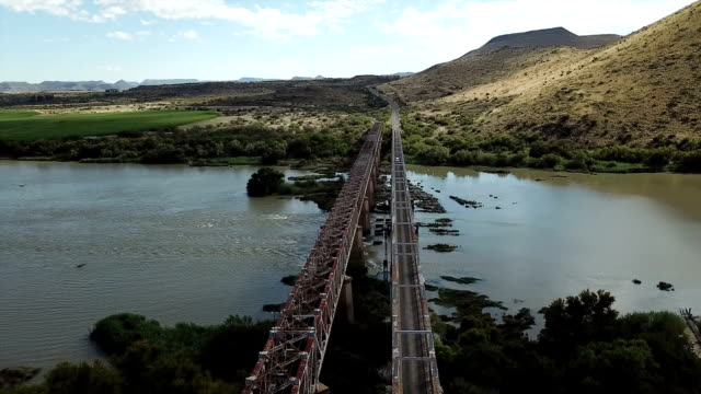 norvalspont rail and road bridge, orange river, eastern cape, south africa - british rail stock videos & royalty-free footage