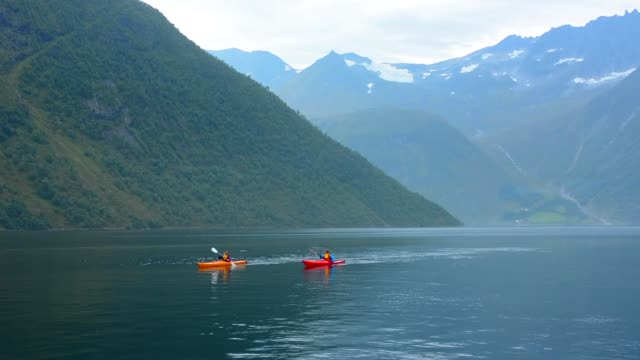 Norway cruise Hurtigruten kayaks fjord beautiful scenic of ship Richard With in Hjorundjorden area of Norway mountains