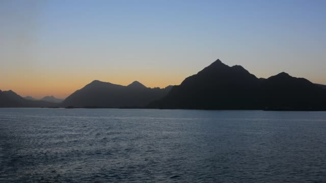 Norway cruise Hurtigruten ship sunset view  the Arctic Circle crossing  sky and islands fjords