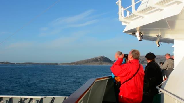norway cruise hurtigruten ship view passenger with binoculars near the arctic circle crossing clean boat and walkway - binoculars stock videos & royalty-free footage