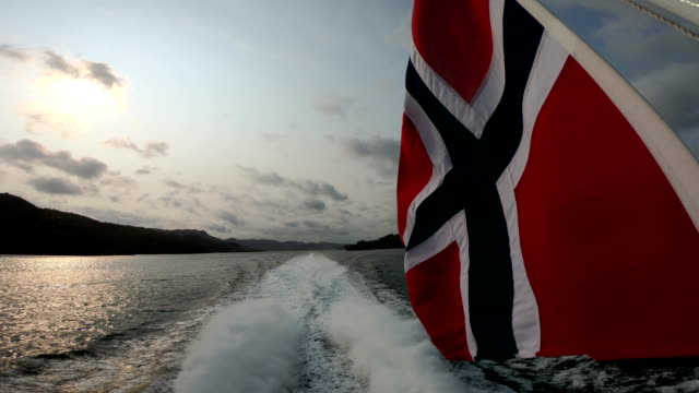 norway flag and sognefjord - nature and travel background - fjord stock videos & royalty-free footage