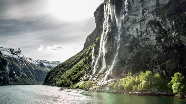 norway, geiranger, geiranger fjord. unesco world heritage site. view on mountains and waterfall - norway stock videos & royalty-free footage
