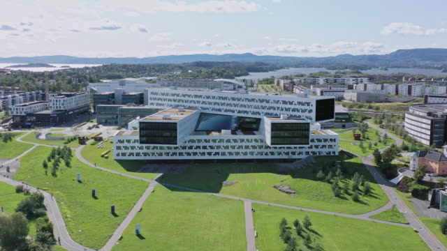 norway oslo fornebu modern sustainable office park buildings 4k video - nachhaltigkeit stock-videos und b-roll-filmmaterial
