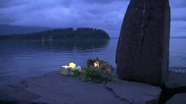 stockvideo's en b-roll-footage met norway's idyllic countryside was traumatized by the deadly shooting spree of 32yearold anders behring breivik who opened fire on a youth camp at... - anders behring breivik