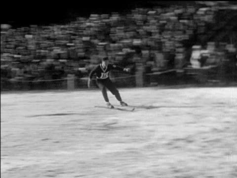 / norwegian aces show unusual skill in skiing finals / various shots of skiers performing on hills norwegian ski jumpers at the 1932 olympics on... - 1932 stock-videos und b-roll-filmmaterial