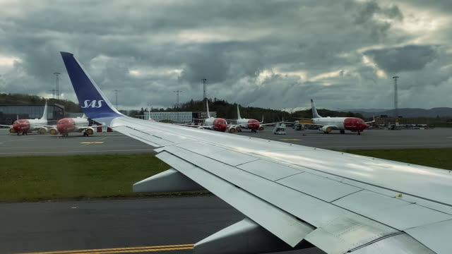 norwegian airlines airplanes on the ground after covid-19 lockdown crisis - nordic countries stock videos & royalty-free footage