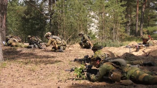 Norwegian and US Soldiers participate in Saber Strike 18 STX Training with US Marines acting as opposition in a situational trianing exercise in...