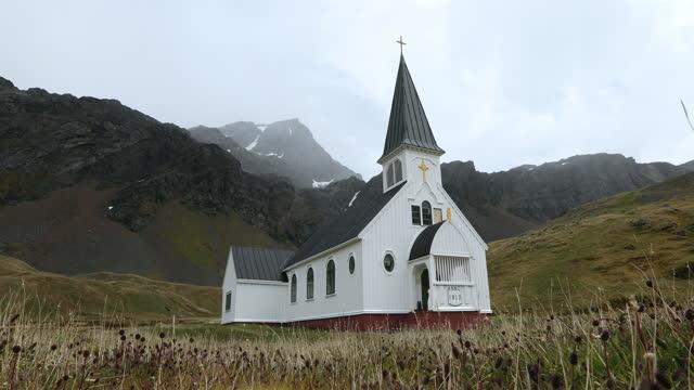 norwegian anglican church in landscape - 大西洋諸島点の映像素材/bロール