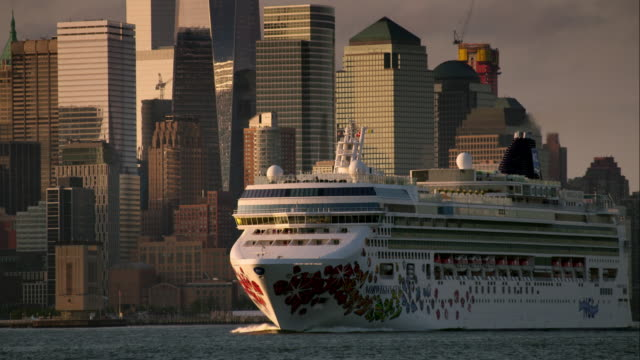 norwegian cruise line moves along hudson river in front of lower manhattan - cruise stock videos & royalty-free footage
